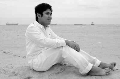 PCHY MOORE SITTING ON BEACH B&W